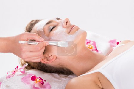 Photo for Cropped image of beautician applying mask on customer's face at salon - Royalty Free Image