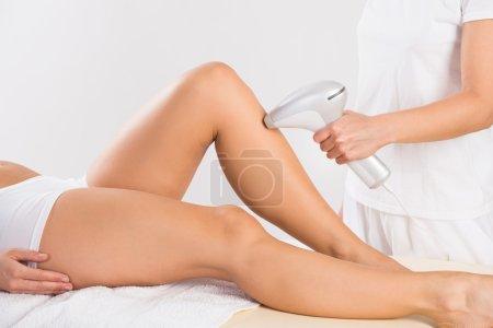 Using Laser Machine On Customer's Leg