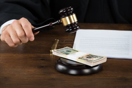 Corrupt Judge Hitting Dollar Bundle