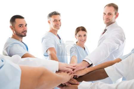 Smiling Medical Team Piling Hands