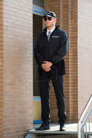 Male Security Guard At The Entrance