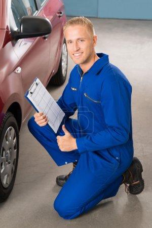 Mechanic Holding Clipboard