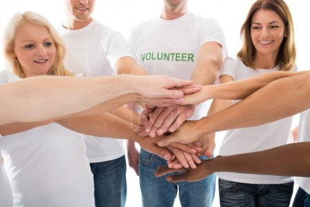Multiethnic Volunteers Stacking Hands