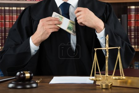 Corrupt Judge Putting Dollar Bundle