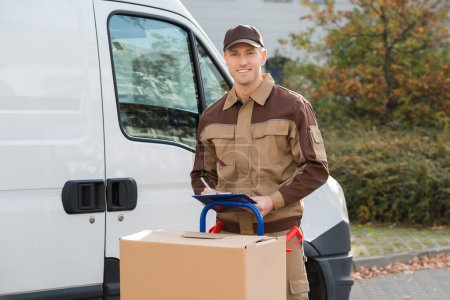 Confident Delivery Man With Parcels
