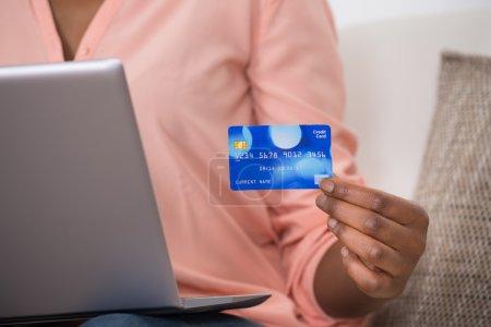 Woman Holding Debit Card