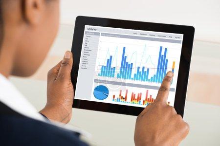 Businesswoman Analyzing Graph