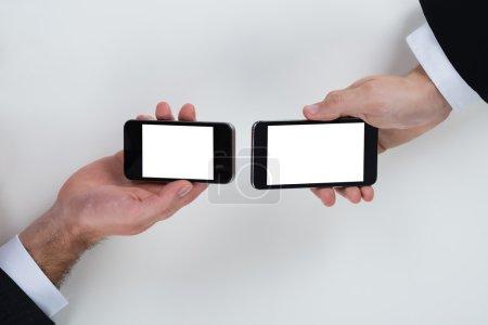 Businessmen Using Mobile Phones
