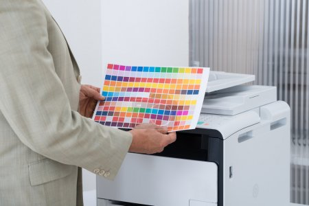 Businessman Holding Multi Colored Paper