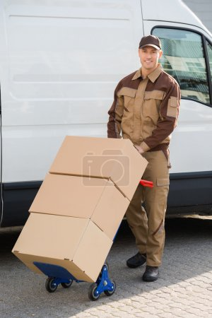 Confident Delivery Man Pushing Parcels