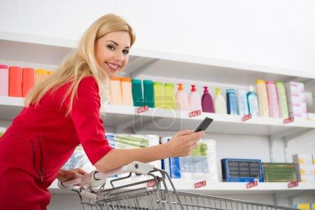 Happy Woman Holding Smartphone