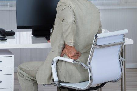 Businessman Suffering From Backache