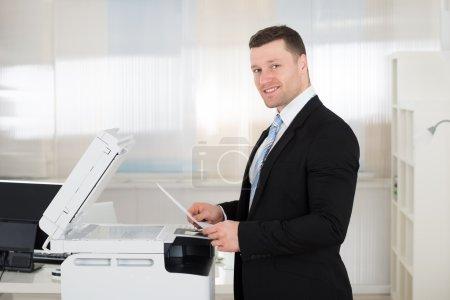Businessman Using Photocopy Machine