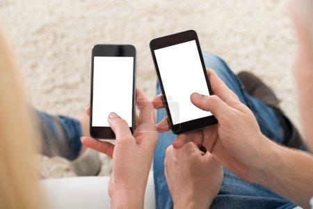 Couple Using Smart Phones