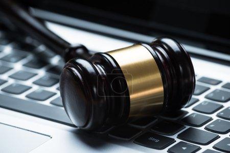 Mallet on laptop keyboard