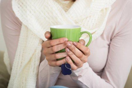Woman Holding Tee Mug