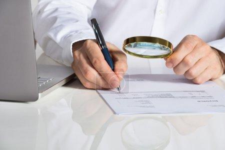 Businessman Analyzing Invoice