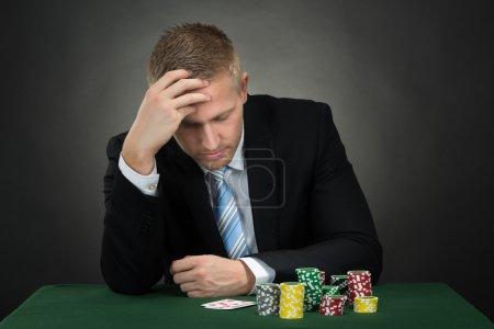 Depressed Poker Player
