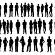 Collage of silhouette business people standing aga...