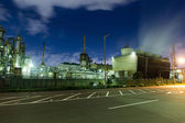 Industrial buildings at large factory at night