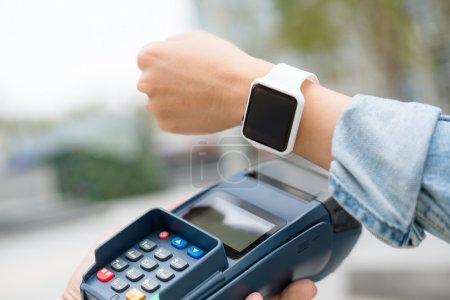 Photo for Woman using smart watch to checkout - Royalty Free Image