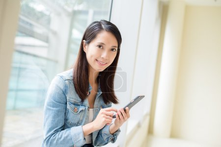 woman using cellphone at indoor