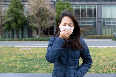 Photo for Asian young woman wearing face mask at outdoor - Royalty Free Image