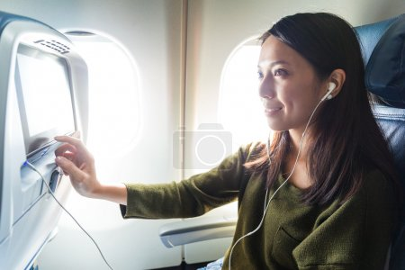 Woman watching movie in airplane