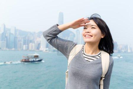 Woman looking far away in Hong Kong