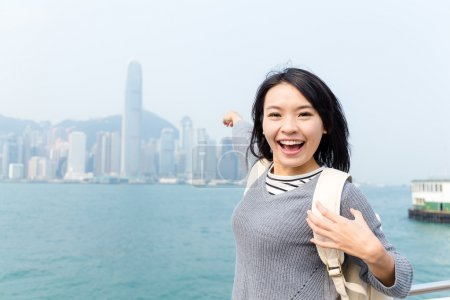 Photo for Excited Asian young woman travelling in Hong Kong city - Royalty Free Image