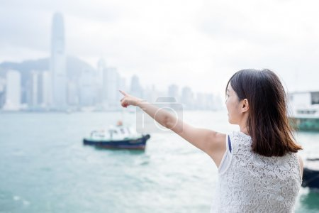 woman pointing to the location in Hong Kong