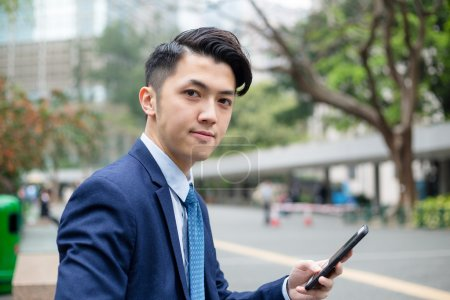 Young asian businessman in business suit