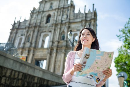 woman with map travelling in Macau