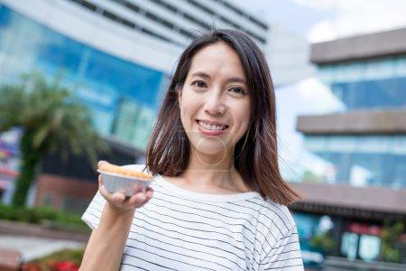 woman holding famous Hong Kong food