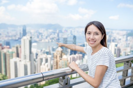 woman pointing to the city of Hong Kong