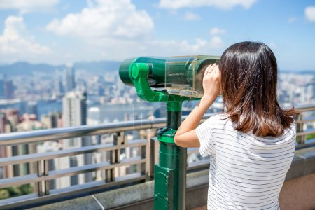 woman tourist looking at Hong Kong cityscape