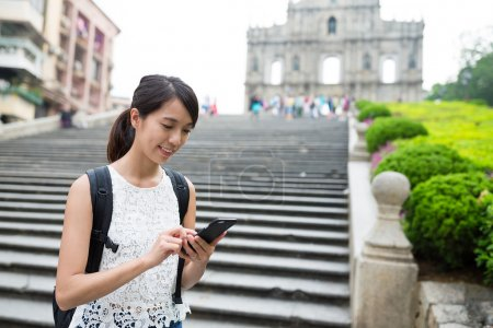 Woman using mobile phone in Macau