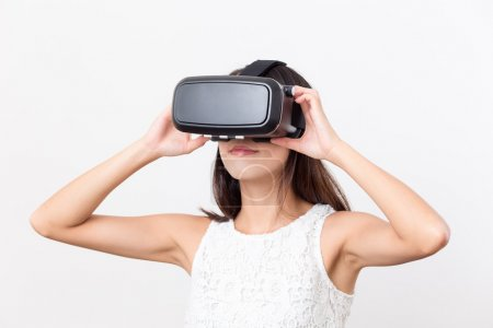 Photo for Asian Woman watching though VR device - Royalty Free Image