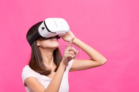 Photo for Asian Woman experience through virtual reality device - Royalty Free Image