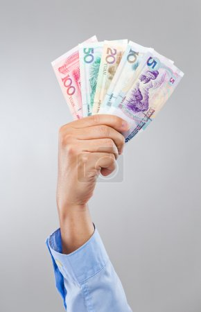 Businessman hand hold with chinese banknote
