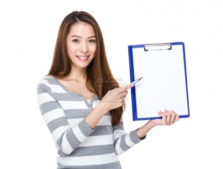 Woman showing blank page of folder