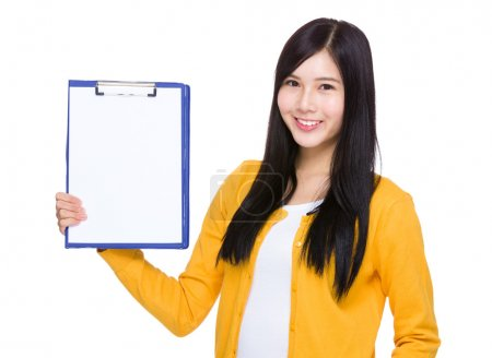 Woman showing blank page on clipboard