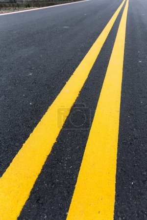 Photo for Two yellow stripes on asphalt road - Royalty Free Image