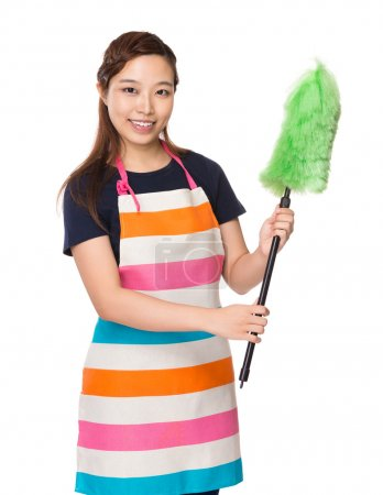 Housewife with cleaning brush