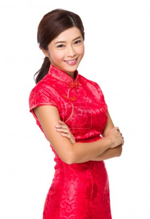 Photo for Asian young woman in red dress with arms crossed - Royalty Free Image
