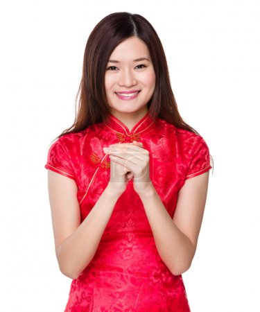 Photo for Asian woman in red dress with hand shake for congratulation sign - Royalty Free Image