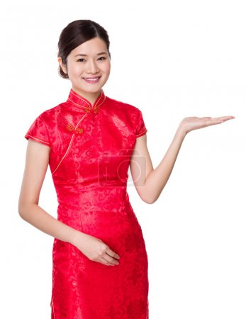 Photo for Chinese young woman with hand presentation - Royalty Free Image