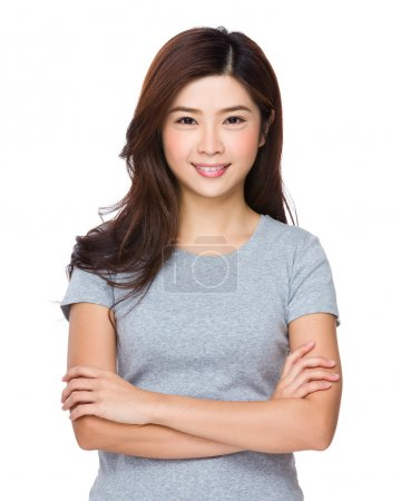 Photo for Asian woman in grey t shirt with arms crossed - Royalty Free Image