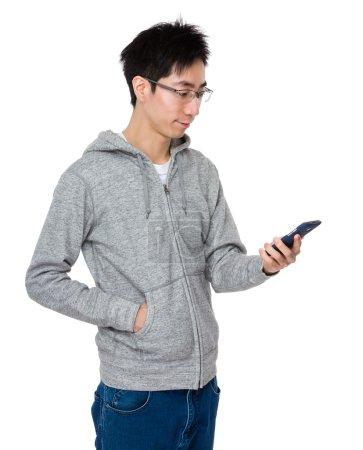 Asian man in grey sweater