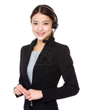 Asian female customer service operator with headse...